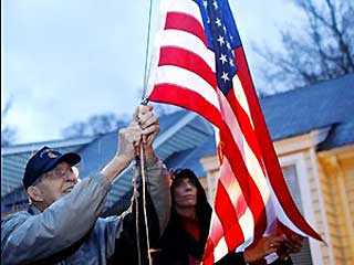 Nov. 2: Col. Van T. Barfoot, 90, and his daughter Margaret Nicholls lower the flag outside Barfoots home in Henrico County, Va.