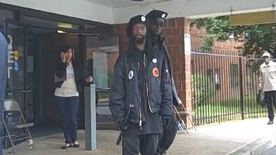 Members of the New Black Panther Party are seen outside a Philadelphia polling station in 2008. (YouTube)