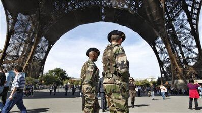 French soldiers patrol under the Eiffel Tower in Paris Oct. 3. (AP Photo)