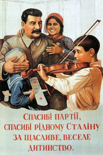 Joseph Stalin with happy children; one is playing the violin