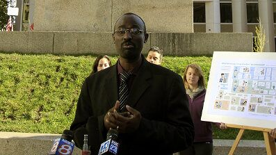 Oct. 19:  Claude Rwaganje, a resident of Portland, Maine for over 13 years, speaks at a news conference. Portland residents will vote in November on a proposal that would give legal residents who are not U.S. citizens the right to vote in local elections.
