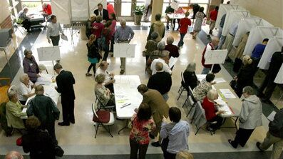 Heavy turnout is being reported at many polling places across the Tuscaloosa area on Tuesday Nov. 2, 2010. Voters braved the rain and endured long lines to vote at Tuscaloosa Academy in Tuscaloosa, Ala. (AP Photo/Tuscaloosa News, Robert Sutton)